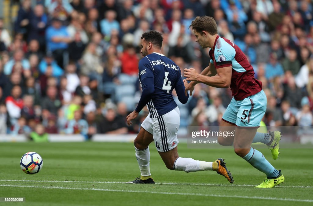 Hal Robson-Kanu of West Bromwich Albion evades James Tarkowski of Burnley and scores the only goal of the game during the Premier League match between Burnley and West Bromwich Albion at Turf Moor on August 19, 2017 in Burnley, England.