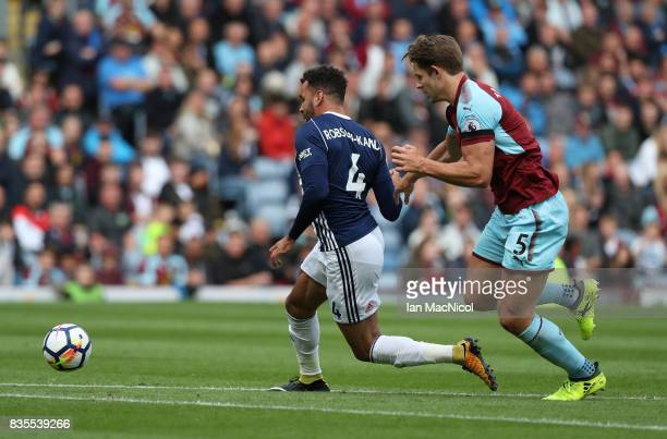 Hal RobsonKanu of West Bromwich Albion evades James Tarkowski of Burnley and scores the only goal of the game during the Premier League match between...