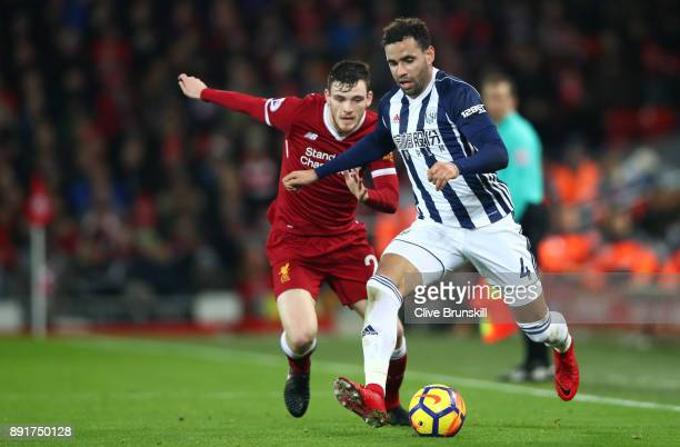 Hal RobsonKanu of West Bromwich Albion is challenged by Andy Robertson of Liverpool during the Premier League match between Liverpool and West...