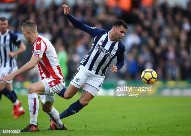 Hal RobsonKanu of West Bromwich Albion is fouled by Ryan Shawcross of Stoke City during the Premier League match between Stoke City and West Bromwich...