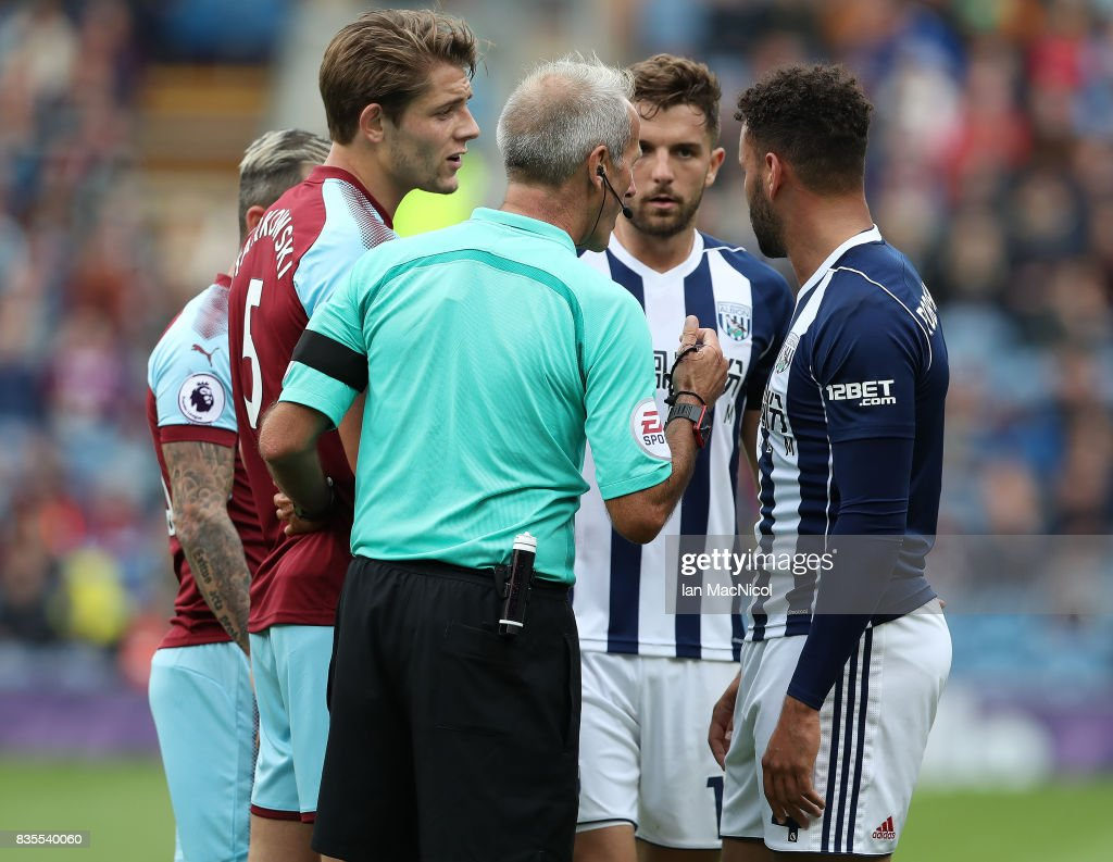 Hal Robson-Kanu of West Bromwich Albion is sent of by referee Martin Atkinson during the Premier League match between Burnley and West Bromwich Albion at Turf Moor on August 19, 2017 in Burnley, England.