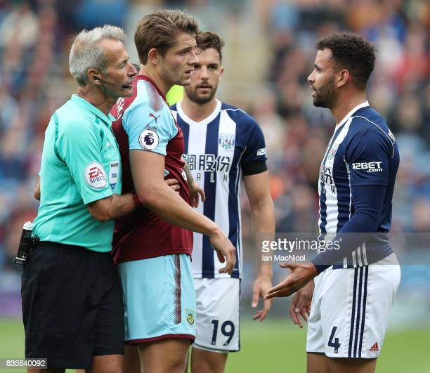 Hal RobsonKanu of West Bromwich Albion is sent of by referee Martin Atkinson during the Premier League match between Burnley and West Bromwich Albion...