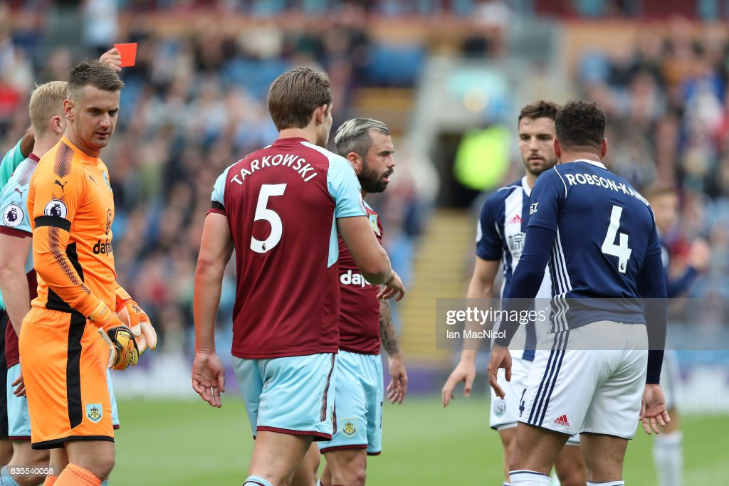 Hal Robson-Kanu of West Bromwich Albion is shown the red card during the Premier League match between Burnley and West Bromwich Albion at Turf Moor on August 19, 2017 in Burnley, England.