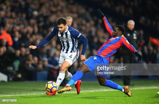 Hal RobsonKanu of West Bromwich Albion is tackled by Jeffrey Schlupp of Crystal Palace during the Premier League match between West Bromwich Albion...