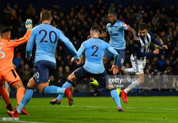 Hal RobsonKanu of West Bromwich Albion scores the first goal during the Premier League match between West Bromwich Albion and Newcastle United at The...