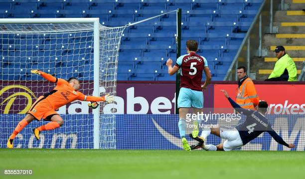 Hal RobsonKanu of West Bromwich Albion scores their first goal during the Premier League match between Burnley and West Bromwich Albion at Turf Moor...