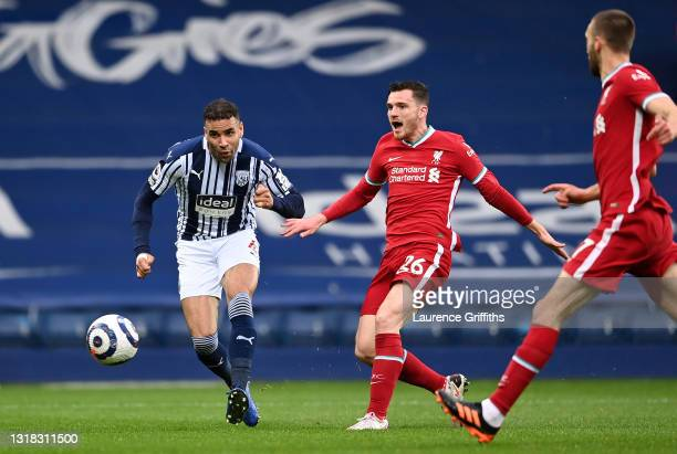 Hal Robson-Kanu of West Bromwich Albion scores their side's first goal whilst under pressure from Andrew Robertson and Nathaniel Phillips of...