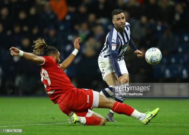 Hal RobsonKanu of West Bromwich Albion shoots past Ashley Williams of Bristol City during the Sky Bet Championship match between West Bromwich Albion...