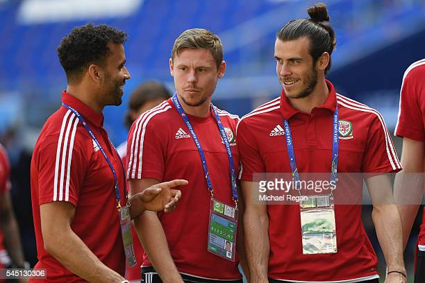 Hal RobsonKanu Simon Church and Gareth Bale look on as the Wales squad visit the Stade de Lyon on July 5 2016 in Lyon France