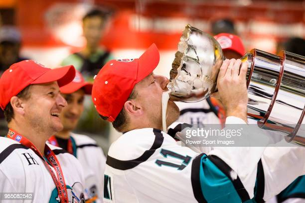 Hal Slominski of Cathay Flyers celebrates with the champion's trophy during the Mega Ice Hockey 5s International Elite Final match between Nordic...