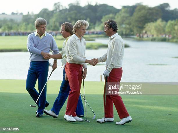 Hal Sutton and Craig Stadler of the United States team, and Bernhard Langer and Jose-Maria Canizares of the European team shake hands after their...