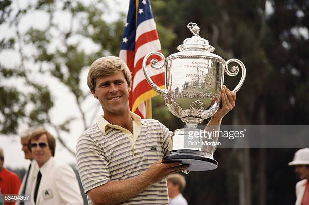 Hal Sutton of the USA lifts the winning trophy after winning the USPGA held in 1983 at the Riviera Country Club in Los Angeles California USA