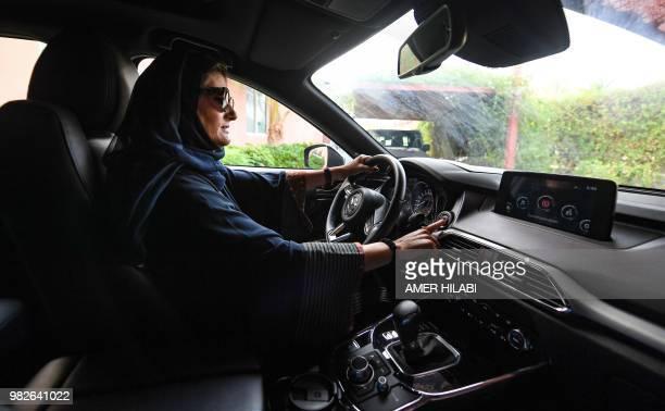 TOPSHOT Hala Hussein Alireza a newlylicensed Saudi motorist drives a car in the Red Sea coastal city of Jeddah early on June 24 2018 Saudi Arabia...