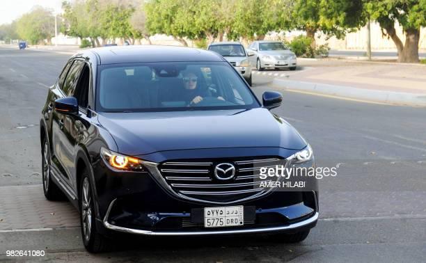 Hala Hussein Alireza a newlylicensed Saudi motorist drives a car in the Red Sea coastal city of Jeddah early on June 24 2018 Saudi Arabia ended its...
