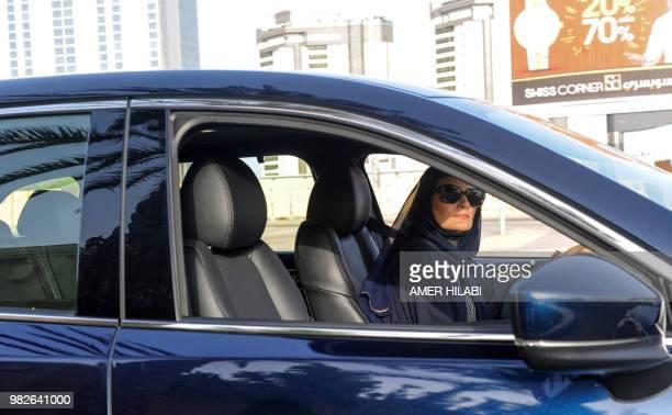 Hala Hussein Alireza a newlylicensed Saudi motorist drives a car on a main road in the Red Sea coastal city of Jeddah early on June 24 2018 Saudi...