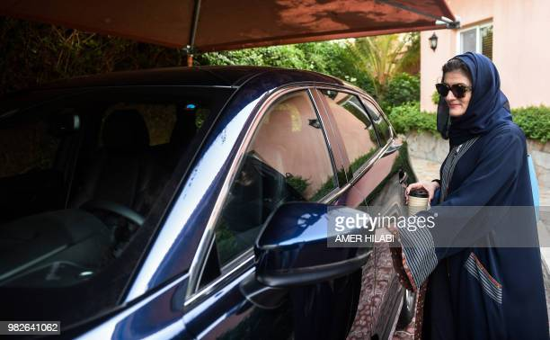 Hala Hussein Alireza a newlylicensed Saudi motorist opens the door of a car before leaving her driveway in the Red Sea coastal city of Jeddah early...