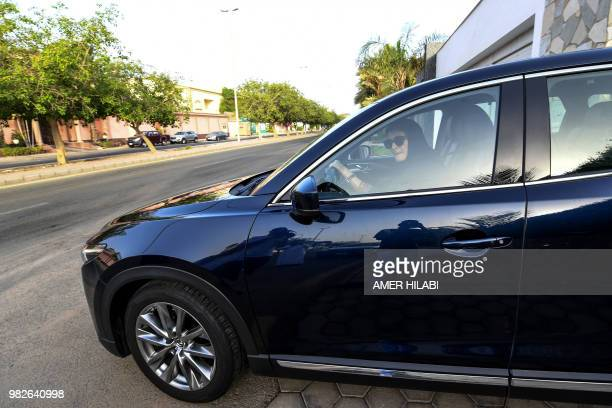 Hala Hussein Alireza a newlylicensed Saudi motorist waits for the road to clear before driving out of a driveway in the Red Sea coastal city of...