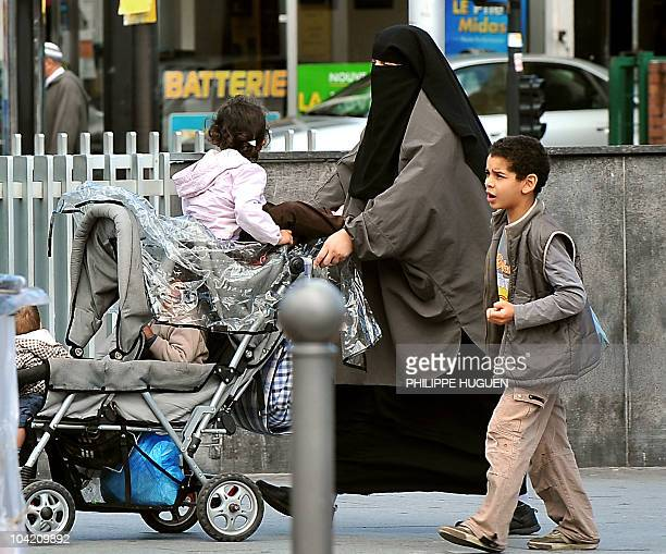 """Halal : après la polémique, le Quick de Roubaix s'est bien développé """". A veiled woman walks in a street of the northern French city of Roubaix on..."""