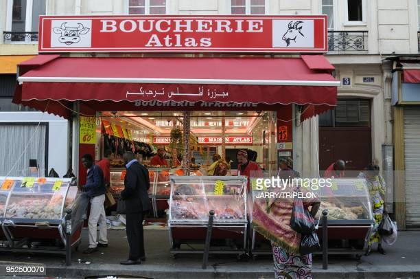 A Halal butcher s shop in the Saint Jean food market of Goutte d Or district 18 th district in Paris Ile de France region France