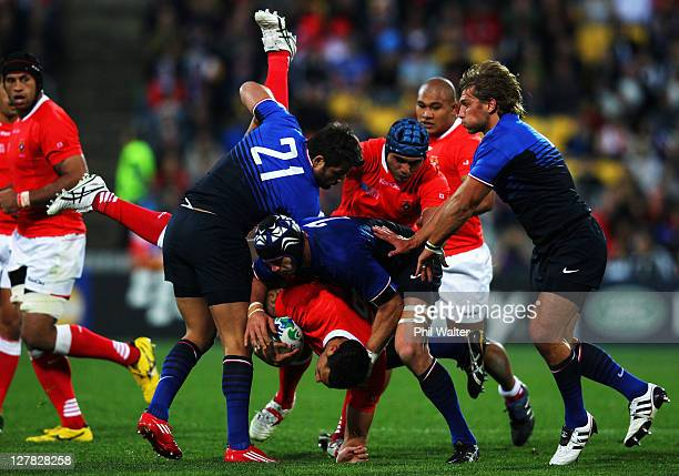 Halani Aulika of Tonga is upeneded by Fabrice Estabanez of France during the IRB 2011 Rugby World Cup Pool A match between France and Tonga at...