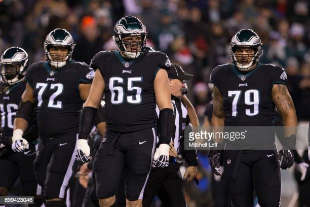 Halapoulivaati Vaitai Lane Johnson and Brandon Brooks of the Philadelphia Eagles look on against the Oakland Raiders at Lincoln Financial Field on...