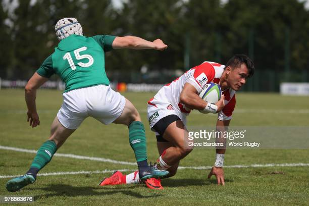 Halatoa Vailea of Japan breaks away from Michael Lowry of Ireland to score a try during the World Rugby Under 20 Championship 11th Place playoff...