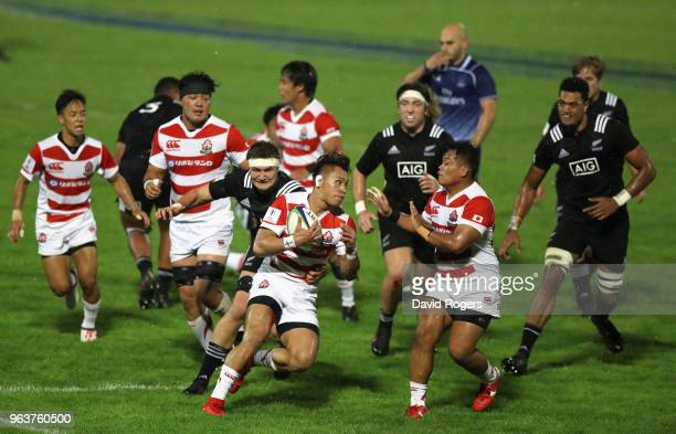 Halatoa Vailea of Japan breaks with the ball during the World Rugby U20 Championship match between New Zealand and Japan at Stade d'Honneur du Parc...