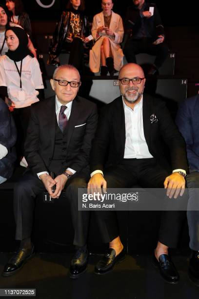 Haldun Boz and Nejdet Ayaydin attend the MercedesBenz Fashion Week Istanbul March 2019 at Zorlu Center on March 20 2019 in Istanbul Turkey