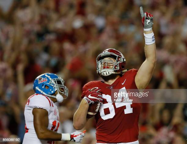 Hale Hentges of the Alabama Crimson Tide reacts after pulling in this touchdown reception against the Mississippi Rebels at BryantDenny Stadium on...