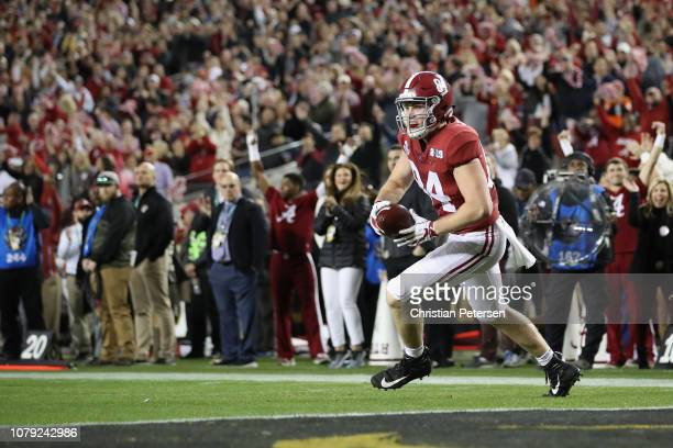 Hale Hentges of the Alabama Crimson Tide scores a first quarter touchdown reception against the Clemson Tigers in the CFP National Championship...