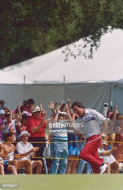 Hale Irwin of the USA celebrates victory with a lap of honour on the 18th hole during the 1990 US Open held at the Medinah Country Club in Medinah...