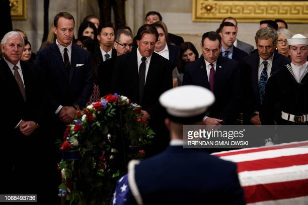 Hale Irwin Peyton Manning Phil Mickelson Mike Krzyzewski and others pay respects as the remains of former US President George H W Bush lie in state...