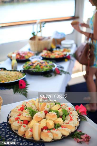 Haleigh Cronin of Newburyport Mass surveyed the catered lunch during a jazz brunch cruise around the North Shore aboard the Hannah Glover boat...