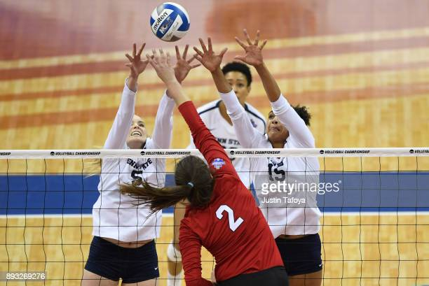 Haleigh Washington and Ali Frantti of Penn State University jump for a block against the University of Nebraska during the Division I Women's...