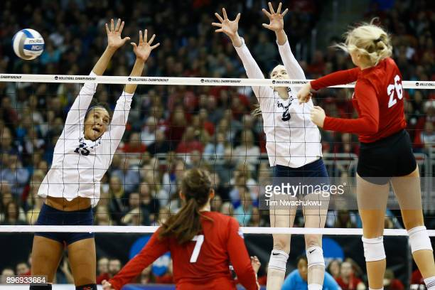 Haleigh Washington and Ali Frantti of Penn State University reach for the ball during the Division I Women's Volleyball Semifinals held at Sprint...