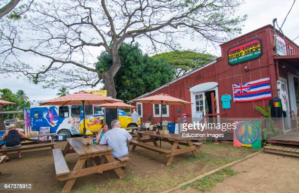 Haleiwa Hawaii Oahu North Shore Old Town Shops Big Wave Shrimp shop and tables