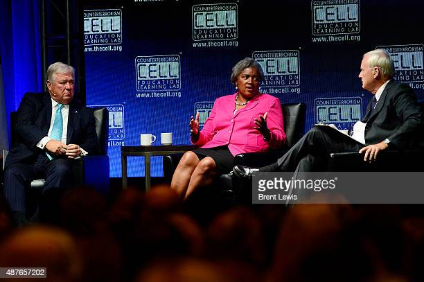 Haley Barbour and Chris Matthews listen while Donna Brazile answers questions during the Colorado Remembers 9/11 Commemoration and Event on September...
