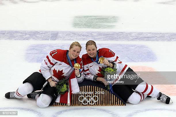 Haley Irwin and Cherie Piper of Canada pose with the gold medals following their team's 20 during the ice hockey women's gold medal game between...