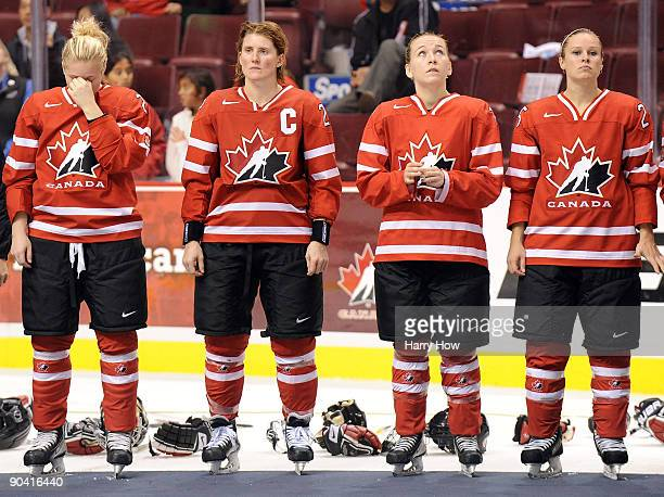 Haley Irwin Hayley Wickenheiser Jocelyne Larocque and Tessa Bonhomme wait for medals after a 12 loss to the USA during the gold medal match of the...