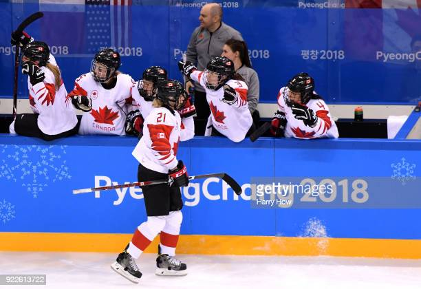 Haley Irwin of Canada celebrates with teammates after scoring a second period goal against the United States during the Women's Gold Medal Game on...