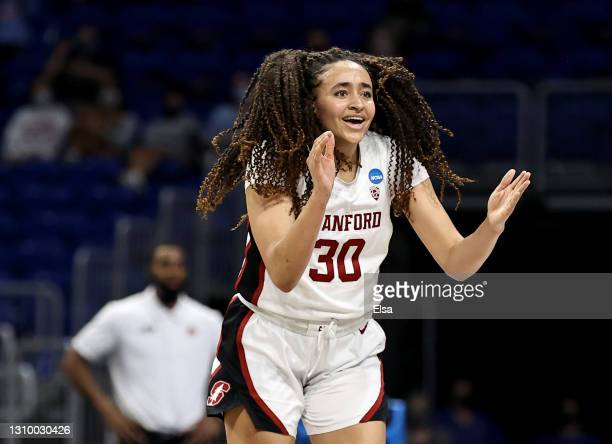 Haley Jones of the Stanford Cardinal celebrates her basket in the second half against the Louisville Cardinals during the Elite Eight round of the...