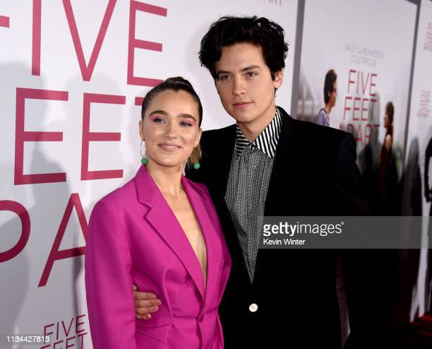 Haley Lu Richardson and Cole Sprouse arrive at the premiere of CBS Films' Five Feet Apart at the Fox Bruin Theatre on March 07 2019 in Los Angeles...