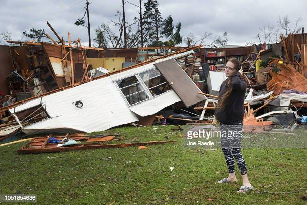 Haley Nelson stands in front of what is left of one of her fathers trailer homes after hurricane Michael passed through the area on October 10 2018...