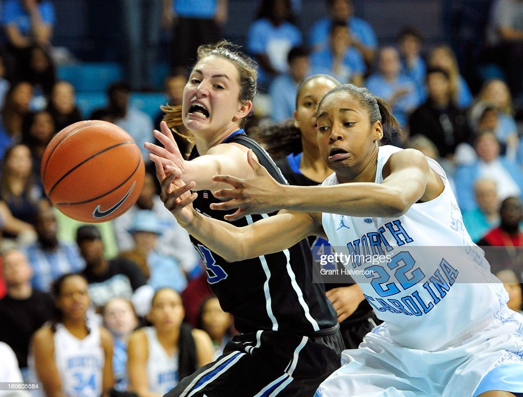 Haley Peters #33 of the Duke Blue Devils battles for a rebound with N'Dea Bryant #22 of the North Carolina Tar Heels during play at Carmichael Arena on February 3, 2013 in Chapel Hill, North Carolina. Duke won 84-63.