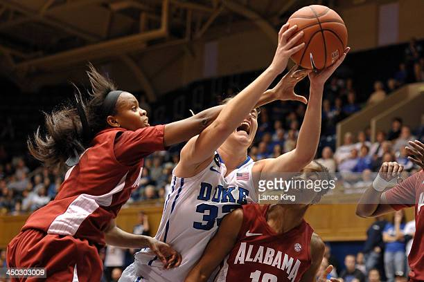 Haley Peters of the Duke Blue Devils is fouled by Daisha Simmons of the Alabama Crimson Tide during a shot attempt at Cameron Indoor Stadium on...