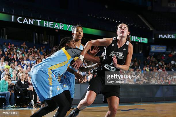 Haley Peters of the San Antonio Stars fights for position against Jessica Breland of the Chicago Sky on September 4 2016 at Allstate Arena in...