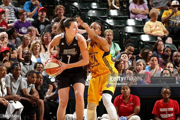 Haley Peters of the San Antonio Stars handles the ball during the game against Tamika Catchings of the Indiana Fever during their WNBA game at...
