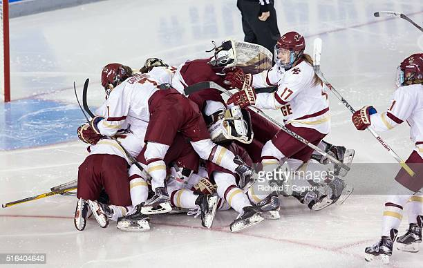Haley Skarupa of the Boston College Eagles celebrates her overtime winning goal against the Clarkson Golden Knights with her teammates Alex...