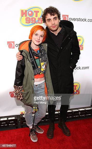 Haley Williams and Taylor York of Paramore on the red carpet at the Hot 995's Jingle Ball 2013 at Verizon Center on December 16 2013 in Washington DC