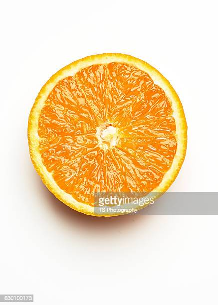 half a fresh orange on a white background